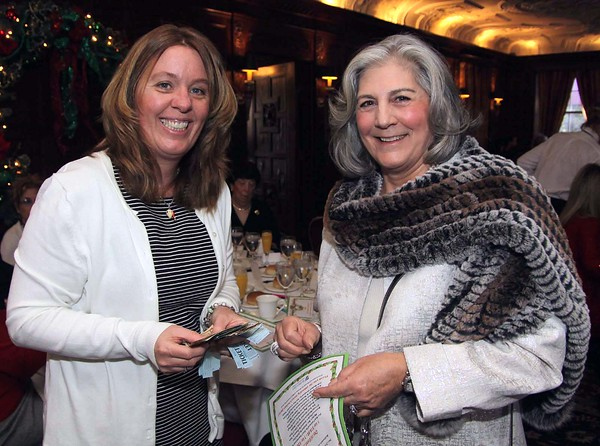 FRANK J. LEONE JR./Courtesy photo<br /> Women of NECC board member Linda McHugh of North Andover, right, models a fur scarf from Dino Furs of Andover that was being raffled off at the event as Cheryl Dick of Haverhill looks on.