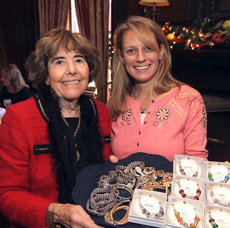 FRANK J. LEONE JR./Courtesy photo<br /> Betty Jaffe of Andover, left, a 20-year member of the Women of NECC board, looks over fine jewelry being sold by Heather Petro of Windham to raise money for college scholarships.