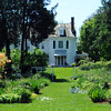 The perennial garden is located behind the house and was designed by Louisa Bancroft Stevens. <br /> Photo by Paul Bilodeau