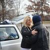 PAUL BILODEAU/Staff photo. Susan Laurin hugs a homeless man living under the Central Bridge in Lawrence near Pemberton Park.