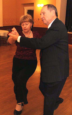 Image # 4942:  Photo by Frank J. Leone, Jr.     Seffi and Frank Small of North Andover do an intricate step on the dance floor,<br /> at the Crystal Ballroom Holiday Ball, Sunday at the Town House, Andover Senior Community Friends.<br /> 12-15-13