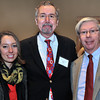 CARL RUSSO/Staff photo.Farewell reception for Addison Gallery of American Art Director Brian T. Allen. Brian T. Allen, center, with Judge John P. Cronin of Andover and his daughter, Holly Cronin, a Phillips Academy graduate, class of 2002. 12/5/2013.