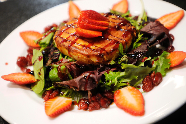 PAUL BILODEAU/Staff photo<br /> <br /> Wrapped Gouda Cheese:<br /> Gouda cheese wrapped in phyllo dough served over mixed greens with berries topped with balsamic glaze.