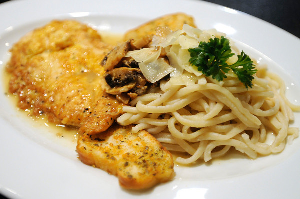 PAUL BILODEAU/Staff photo<br /> <br /> Chicken Francese:<br /> Chicken breast lightly dipped in an egg batter topped with lemon and mushrooms, served over linguini in a white lemon butter sauce.