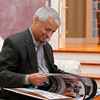 Gururaj (Desh) and his wife Jaishree Deshpande have encouraged the use of entrepreneurship and innovation as catalysts for sustainable change in the United States, India and Canada since 1996.  He looks through a book in his home in Andover. Photo by Mary Schwalm  12/18/2013
