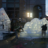 """The crew from Brilliant Ice Sculpture work on the carving """"Buffy"""", a seven-foot-tall bulldog, outside the Prudential Center on Boylston Street as the sun goes down.<br /> Photo by Ryan Hutton."""