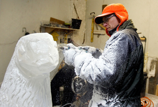 MARY SCHWALM/Staff photo <br /> Don Chapelle works on a seal for an ice sculpture for First Night in Boston at the the New England Aquarium at his studio in the Cardinal Shoe Mill in Lawrence.  12/23/13