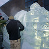 """The crew from Brilliant Ice Sculpture work on the carving """"Buffy"""", a seven-foot-tall bulldog, outside the Prudential Center on Boylston Street during Boston's First Night celebration. Photo by Ryan Hutton."""