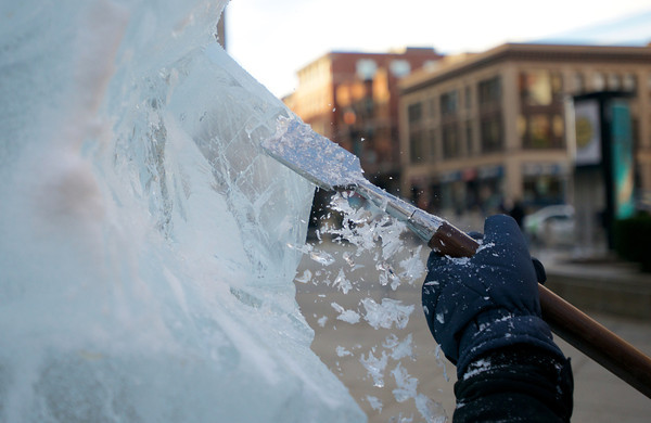 Chapelle uses chain saws, chisels, knives, drills and a variety of smaller, finer tools to make the ice come alive.<br /> Photo by Ryan Hutton.