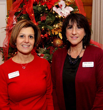 Photo by Frank J. Leone, Jr.     At left, Maria Consoli, branch manager and Linda Joaquin, mortgage originator, both of<br /> The Savings Bank of Andover, at the Merrimack Valley Chamber of Commerce Business Networking Mixer, Tuesday,<br /> Andover Country Club, Andover.<br /> 12-17-13