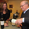 Photo by Frank J. Leone, Jr.     Jeanne Baylies samples one of Joesph Carr's wines with Wayne Niemi of Ruby Wines,<br /> distributors, both are from North Andover,  <br /> at the Wine and Sign with Howie Carr and Joseph Carr, Saturday, Wine ConnecXtion, North Andover.<br /> 12-14-13