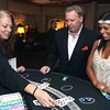 Photo by Frank J. Leone, Jr./ Special to The Andover Townsman       At the Black Jack table, from left, dealer Kim Flynn of<br /> Hampstead with Patrick Leyne and Lauren Hajjar, both of Andover,   <br /> at the 11th Annual Spirit of Giving Speakeasy Gala to Benefit Ironstone Farm, Andover.<br /> 11-16-13