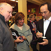 Photo by Frank J. Leone, Jr.     At left, Bob and Mary Stowers of North Andover receive a signed bottle of vintner Joseph Carr's<br /> Nappa Valley wine bearing his name,  <br /> at the Wine and Sign with Howie Carr and Joseph Carr, Saturday, Wine ConnecXtion, North Andover.<br /> 12-14-13