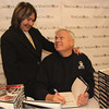 "Photo by Frank J. Leone, Jr.     Wendy Stern of North Andover gets a signed copy of radio personality Howie Carr's<br /> best selling book ""Ratman"": The Trial and Conviction of Whitey Bulger,  <br /> at the Wine and Sign with Howie Carr and Joseph Carr, Saturday, Wine ConnecXtion, North Andover.<br /> 12-14-13"