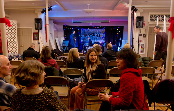 Attendees chat between musical acts at the Crossroads Coffee House in North Andover, located in the basement of the North Parish Unitarian Universalist Church. Photo by Maria Uminski