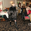 AMY SWEENEY/Staff photo. Karen Andreas, publisher of the North of Boston Media, models a fur by Dino Furs at the fashion show for Women of Northern Essex Community College Holiday Party held at the Andover Country Club.<br /> December 1, 2014