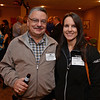 RYAN HUTTON/ Staff photo<br /> From left, Jim Tomacchio, director of pharmacy at Performix Specialty Pharmacy, and Charlotte Hook, lead technician at Performix Specialty Pharmacy at the Merrimack Valley Chamber of Commerce's Ring in the Holidays Business Networking Mixer.
