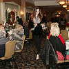 AMY SWEENEY/Staff photo. Emilie Zinsmeister models a fur by Dino Furs at the fashion show for Women of Northern Essex Community College Holiday Party held at the Andover Country Club.<br /> December 1, 2014