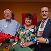 RYAN HUTTON/ Staff photo<br /> From left, Richard Payeur, owner of Payeur Silk Flowers, Carol Reebenacker, from Accelerate Energy, and Donald Gottfried, from the Bullfinch Group at the Merrimack Valley Chamber of Commerce's Ring in the Holidays Business Networking Mixer.