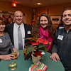 RYAN HUTTON/ Staff photo<br /> From left, Mary Ellen Lawlor, from Servpro, Craig Leduc from Aflac, Emily Hiker, and Michael Bevilacqua from the Merrimack Valley Chamber of Commerce at the Merrimack Valley Chamber of Commerce's Ring in the Holidays Business Networking Mixer.