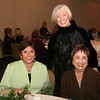 AMY SWEENEY/Staff photo. Kathy Tarro, left, of Andover, Joan Pelletier, and Natalie Bradley, of North Andover at the Women Fashion Show for Women of Northern Essex Community College Holiday Party held at the Andover Country Club.<br /> December 1, 2014