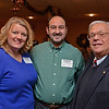 RYAN HUTTON/ Staff photo<br /> From left, Barriann and Roberto Alonzo, owners of Eva's Farm Organic Butcher Shop and Merrimack Valley Chamber of Commerce President Joe Bevilacqua at the Merrimack Valley Chamber of Commerce's Ring in the Holidays Business Networking Mixer.