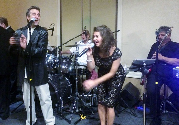 "The B Street Bombers were the featured performing act at The Northeast Independent Living Program, Inc. (NILP), event held at the Wyndham Andover Hotel on September 26, 2014. They were performing their ""High Energy Music in Support of All People With Disabilities"" to a sellout audience of over 200 people that also enjoyed a buffet dinner that was offered to attendees at this event. In addition, raffle items and silent auction items that were all donated by individuals or members of the local business were awarded to lucky winners who attended this event. The evening was a great success with all proceeds going to support NILP's services, programs, and advocacy for all people with disabilities who wish to live independently in the community in the 52 cities and towns that NILP serves in Northeast Massachusetts."
