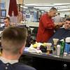 RYAN HUTTON/ Staff photo<br /> Barber Alex Ramirez cuts the hair of customer Sam Vecchi at the Andover Barber Shop on Main Street.