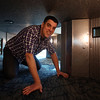 DAVID LE/Staff photo. Michael Horvath, an Andover resident, is the Exhibit Manager at the Museum of Science in Boston. Horvath kneels in a crawl space designed for kids as part of an interactive welcoming area, overlooking the Charles River, that is set to open this Spring. 3/11/16.