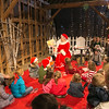 Photo/Reba Saldanha  Mrs. Claus, played by Judy Nigrelli on North Andover, reads a story during Tea with Mrs. Claus, part of Smolak Farms' holiday events December 13, 2015