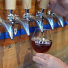 RYAN HUTTON/ Staff photo<br /> Oak & Iron Brewing owner Jim Cass pours a pint of their Red Spring Ale.