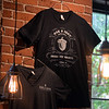 RYAN HUTTON/ Staff photo<br /> An  Oak & Iron Brewing t-shirt hangs on the wall of the pub room.
