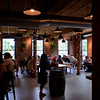 RYAN HUTTON/ Staff photo<br /> The pub room at Oak & Iron Brewing brims with customers in mid June.