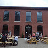 RYAN HUTTON/ Staff photo<br /> The outside patio at Oak & Iron Brewing is filled with customers.