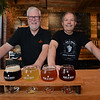 RYAN HUTTON/ Staff photo<br /> Oak & Iron Brewing owners John Helferich, left, and Jim Cass, right, stand behind the bar of their establishment on Sunday.