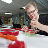 MARY SCHWALM/Staff photo Johanna Myers, of Paxton, Mass., works with a felting tool to create a matching color for a late 18th Century red cloak for the Haverhill Historic Society at the Museum Textile Services, a textile conservation and restoration company in Andover. 6/9/14