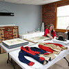 MARY SCHWALM/Staff photo Camille Breeze, Director at the Museum Textile Services, prepares to work on the restoration of a piece of work from the Masons at the textile conservation and restoration company in Andover. 6/9/14