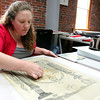 MARY SCHWALM/Staff photo Camille Breeze, Director at the Museum Textile Services, works on the restoration of a piece of work from the Masons at the textile conservation and restoration company in Andover. 6/9/14