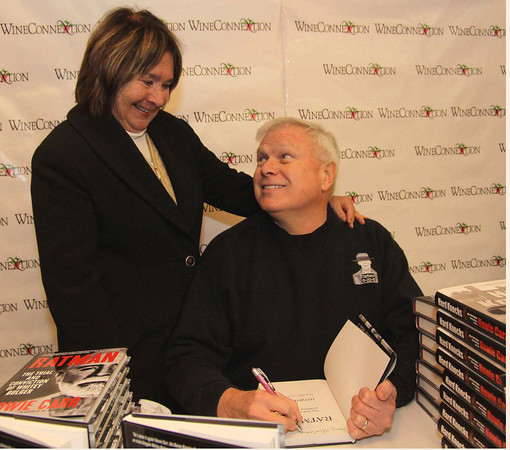 """Photo by Frank J. Leone, Jr.     Wendy Stern of North Andover gets a signed copy of radio personality Howie Carr's<br /> best selling book """"Ratman"""": The Trial and Conviction of Whitey Bulger,  <br /> at the Wine and Sign with Howie Carr and Joseph Carr, Saturday, Wine ConnecXtion, North Andover.<br /> 12-14-13"""