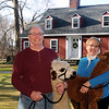 Tom and Jen Boshar of Andover, owners of Big Red Acres Registered Huacaya Alpacas, have a family photo taken with two of several Alpacas they own. Tom holds Tabitha, the mother of Apollo being held by Jen. A baby Alpaca is called a Cria. <br /> CARL RUSSO/Staff photo.