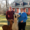 Tom and Jen Boshar of Andover, owners of Big Red Acres Registered Huacaya Alpacas, have a family photo taken with two of several Alpacas they own. Tabitha, the mother of Apollo, a baby Alpaca also called a Cria. <br /> CARL RUSSO/Staff photo.
