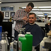 RYAN HUTTON/ Staff photo<br /> Barber Roger Desharnais trims tieback of customer Richard Maher's neck at the Andover Barber Shop.