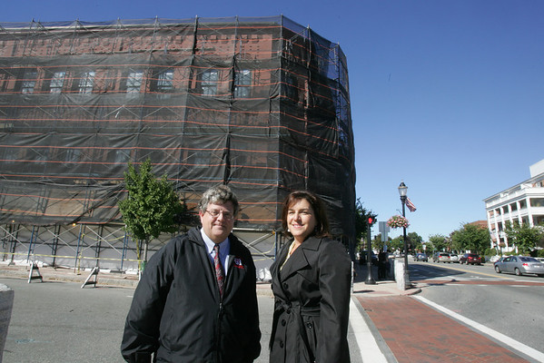 Robert Lelacheur Jr, Town Manager and Jean Delios, Town Planner stand in front of the M.F. Charles Building in downtown Reading. Photo by Angie Beaulieu