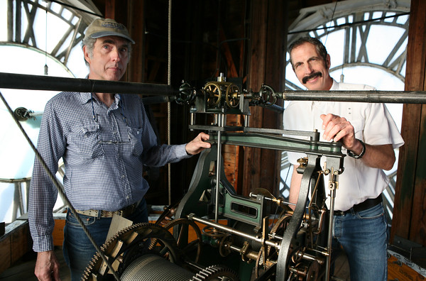 James Robers and his brother David Robers from The Clockfolk of New England have been winding the clock at the Old South United Methodist Church for years.<br /> The clock has to be hand wound every week.<br /> Photo by Amy Sweeney