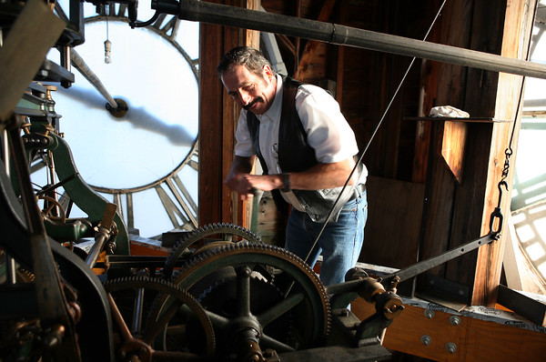 David Robers from The Clockfolk of New England winds the clock at the Old South United Methodist Church. He and his brother James have been taking care of the clock and winding it for years.<br /> <br /> Photo by Amy Sweeney