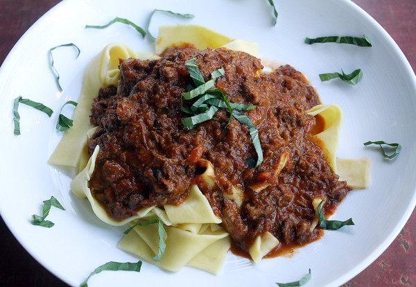 Angie Beaulieu photo. Venetian Moon's signature dish, Braised Pappardelle Ragu. Beef and pork slow braised in a savory cabernet and beef demi-glace sauce tossed with fresh papprdelle pasta and a touch of plum tomato sauce.