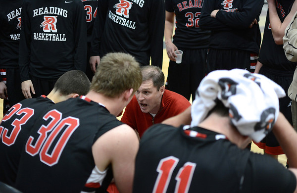 RYAN HUTTON/ Staff photo.<br /> Reading boys basketball coach Paul Morrissey gives his team some encouragement during a time out in their game against North Andover on Jan. 12.