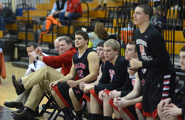 RYAN HUTTON/ Staff photo.<br /> Reading boys basketball coach Paul Morrissey and his team react to a bad play during their game against North Andover on Jan. 12.