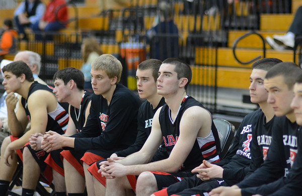 RYAN HUTTON/ Staff photo.<br /> The Reading boys basketball team watches in unison as one of their teammates puts up a shot in their game against North Andover on Jan. 12.