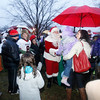 MARY SCHWALM/Staff photo Santa arrives as locals brave the weather for the annual tree lighting on the common in Reading.  12/1/13